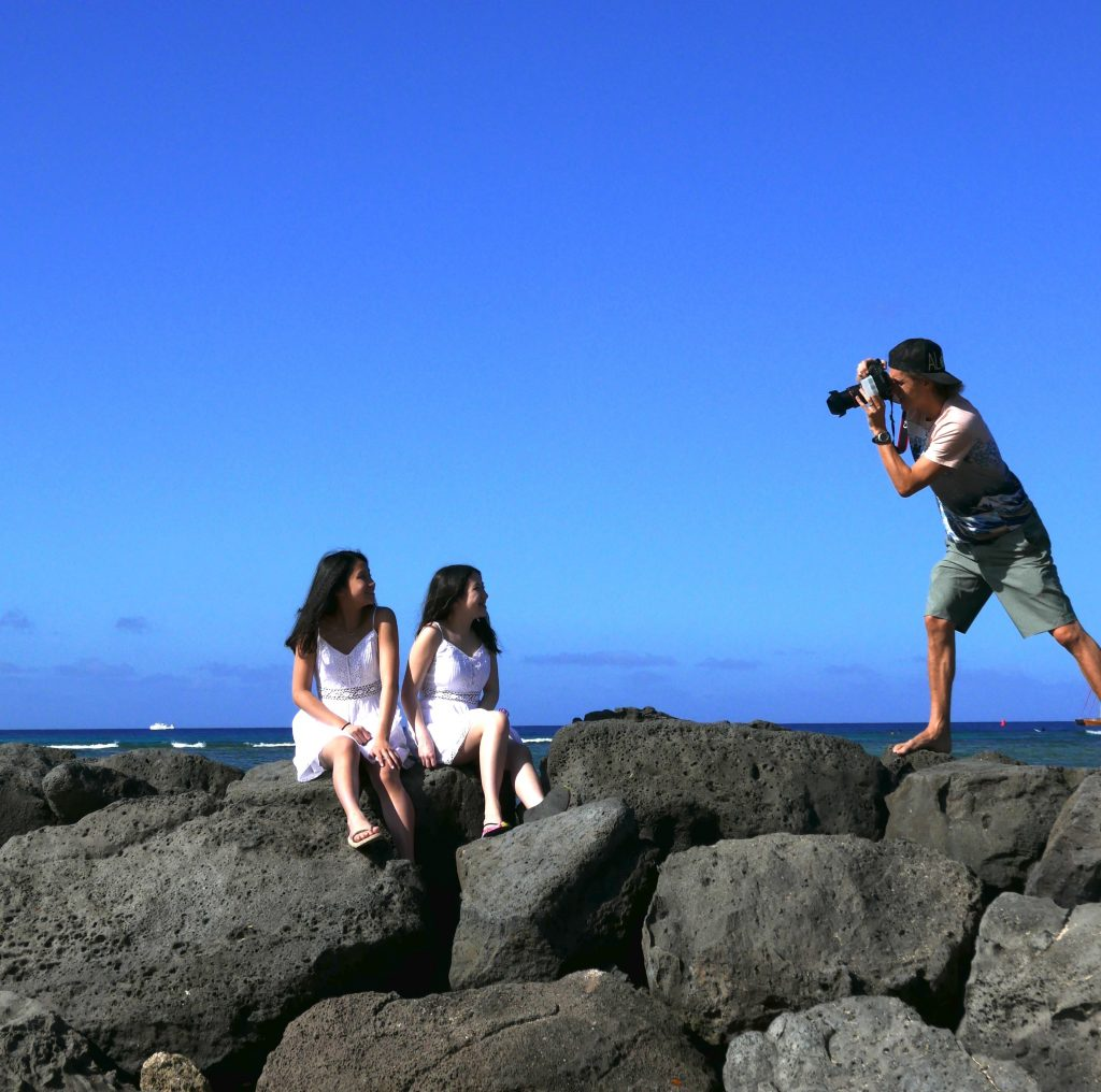Hawaii Photographer Pasha at work in Waikiki, Honolulu, Oahu Photo by: Customer image